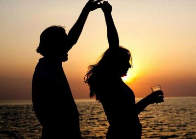 Couple dancing at a Key West Sunset Cruise Party