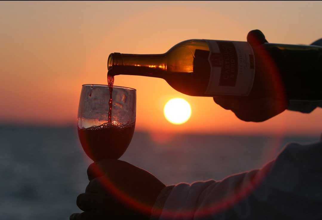 Wine being poured during a Key West Sunset Cruise