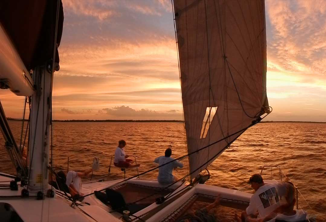 People sitting on bow of boat during a Key West Sunset Cruise