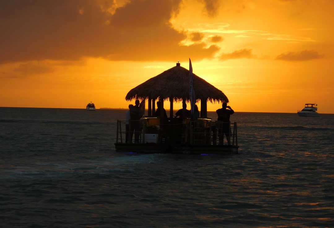 Tiki boat party on a Key West sunset cruise