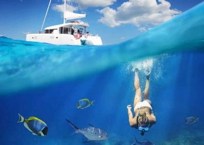 Girl swims down to reef during key west snorkeling trip