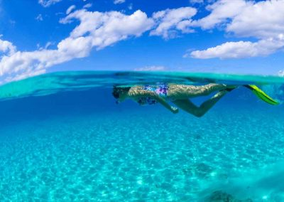 girl swims in crystal clear water with key west snorkeling