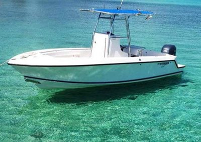 a key west boat rental rests in crystal clear water