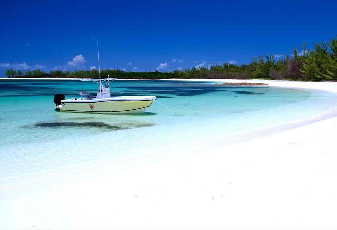 a key west boat rental pulls up on a remote beach