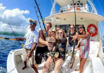 a group of people having fun on a key west deep sea fishing charters trip