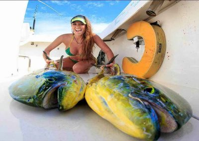 girl displays her mahi-mahi with key west deep sea fishing