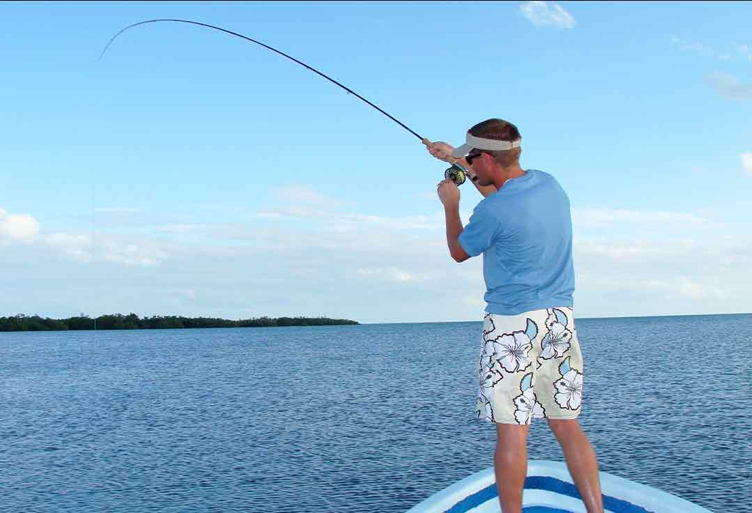 man fly fishes on flats with key west fishing charters