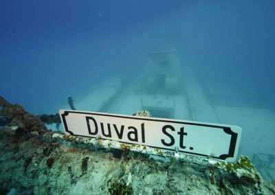 a photo of the famous Duval street sign on the USNS Vandenberg with Key West Scuba Diving.