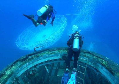 divers explore the satellite dishes on the USNS Vandenberg with Key West Scuba Diving.