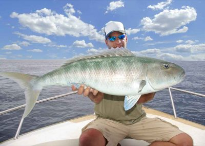 man holds fish with key west fishing charters