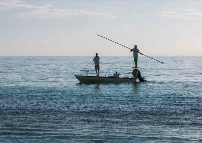 Man casts fly rod with Key West flats fishing