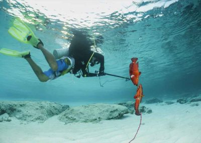 Man with Two fish with Key West Spearfishing