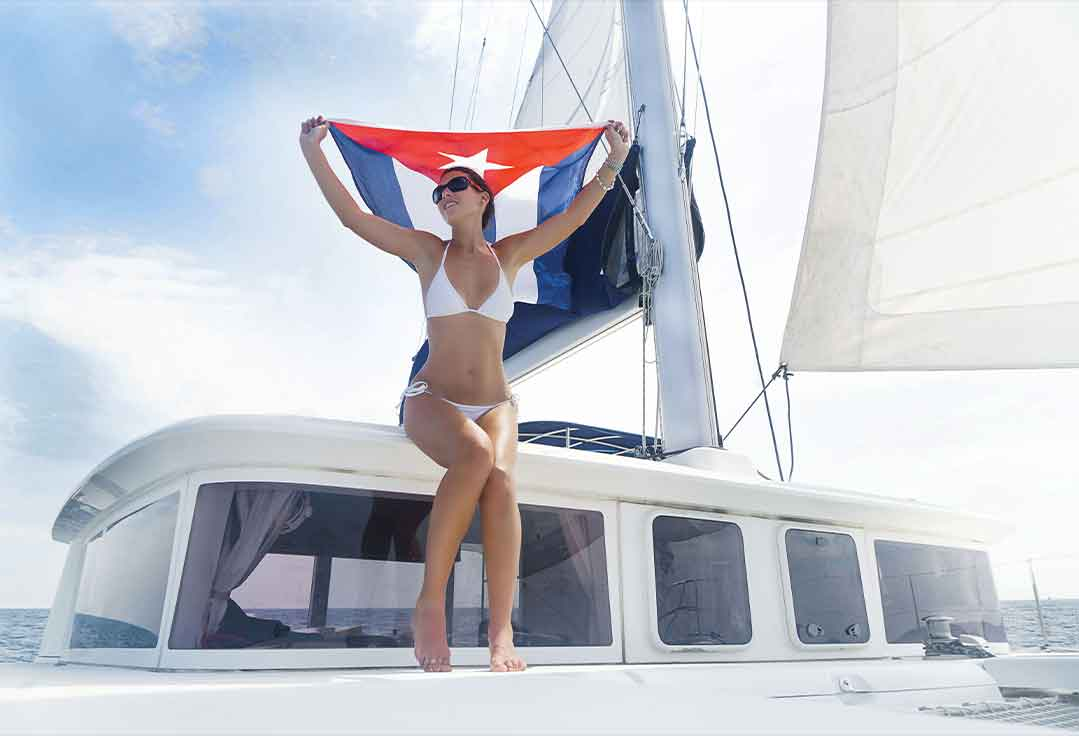 a lady with a Cuban Flag Sails to Cuba with Key West To Cuba