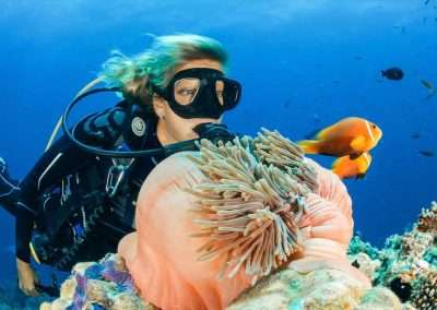 A lady scuba dives the reefs with Key West To Cuba