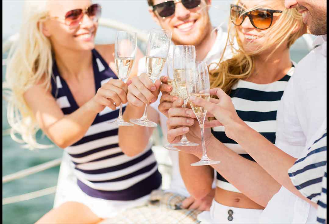 Girls drinking champagne with key west yacht rentals
