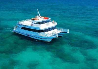 A Key West Glass Bottom Boat is out exploring the barrier reef