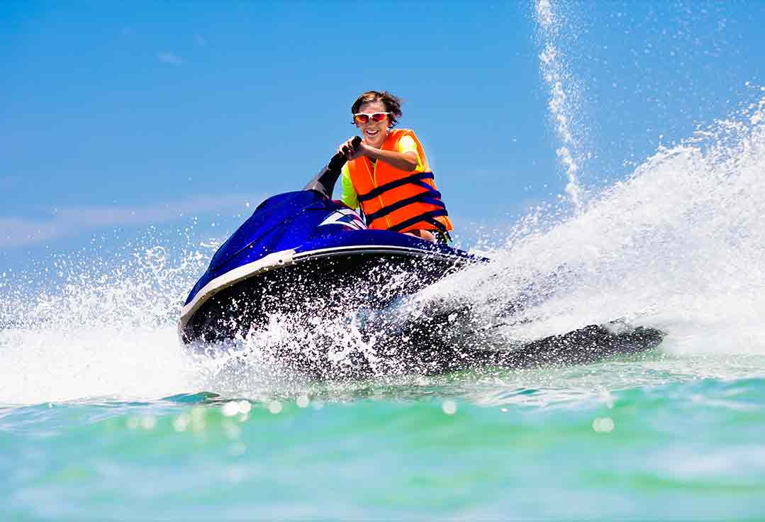 A young man spins out a waverunner with key west jet ski rental